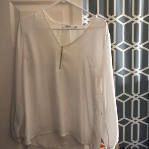 White blouse with gold zipper
